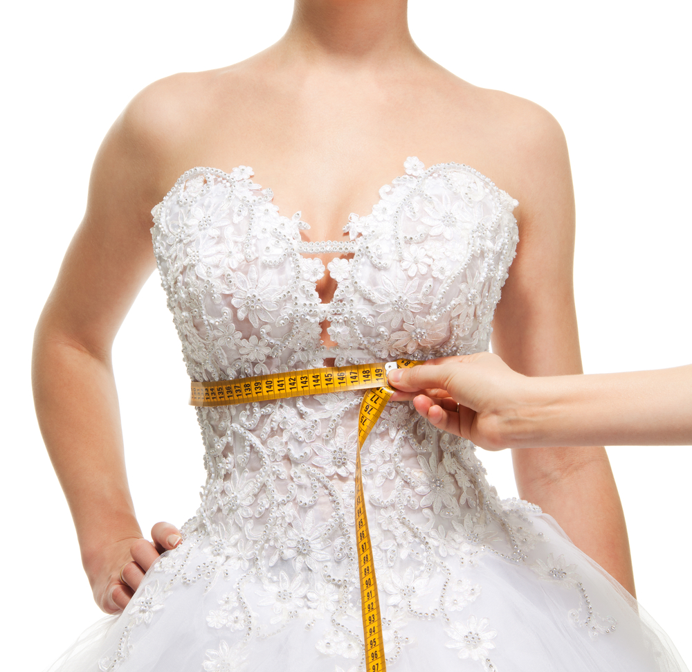 Bride's waist being measured after laser fat removal by Emerald Laser