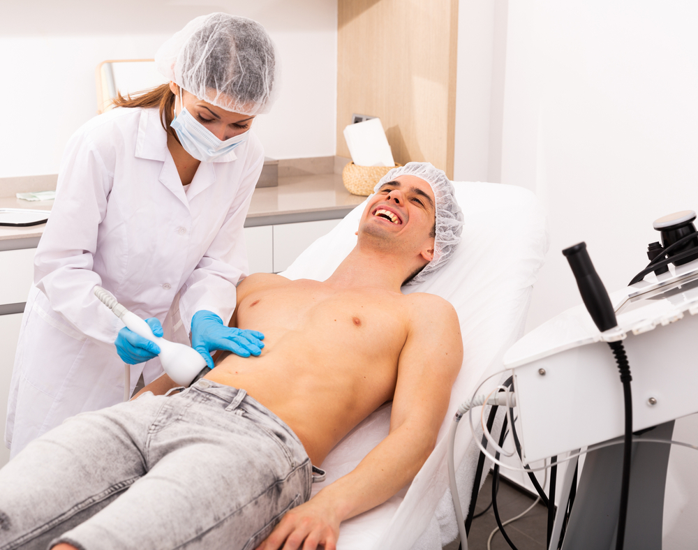 A man comfortable enjoying laser fat removal service by Emerald Laser