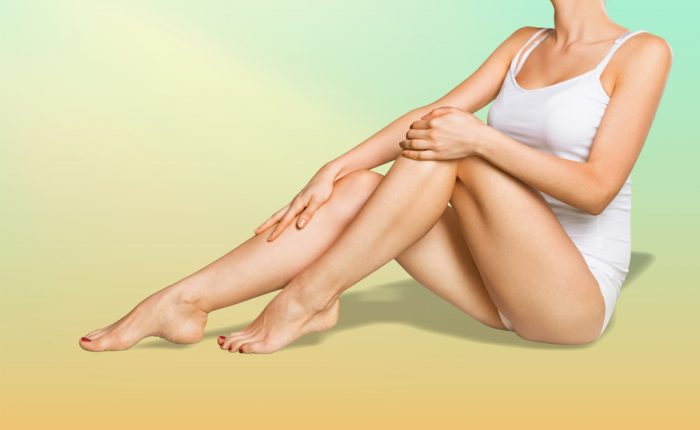 Model showing off laser fat removal by Emerald Laser